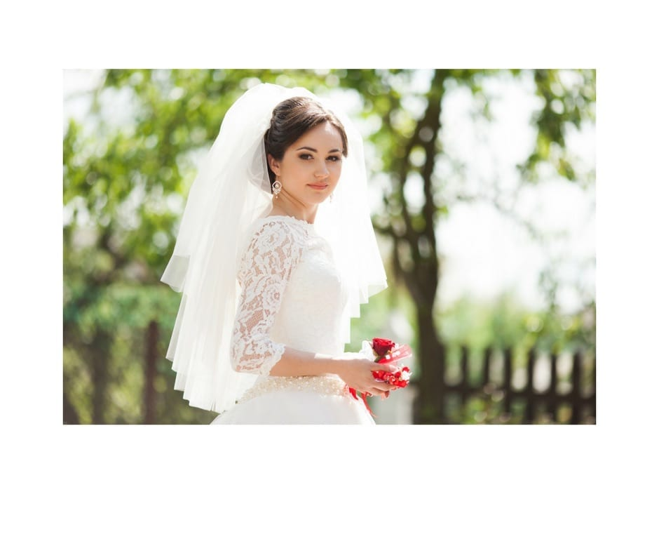 beautiful bride at an outdoor wedding, wonderful lace beading on wedding dress