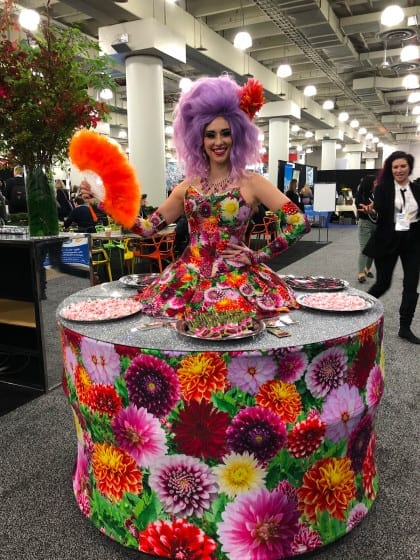 Woman wearing table-dress with mints to hand out at bizbash ny