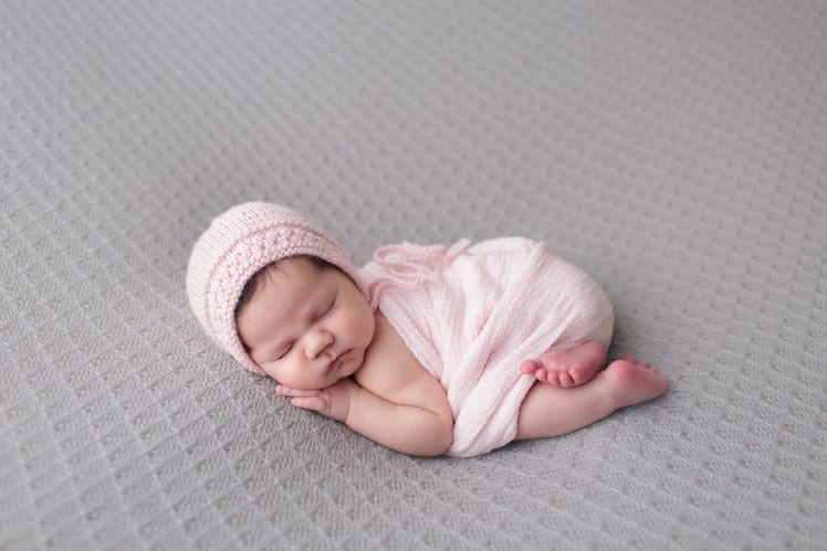 newborn baby photo in bum up pose